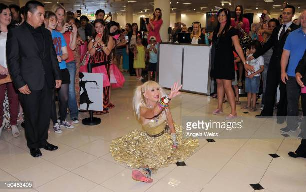 Fashion designer Betsey Johnson celebrates the 10 year anniversary of The Grove with a one-of-a-kind anniversary shoe at The Grove on August 18, 2012...