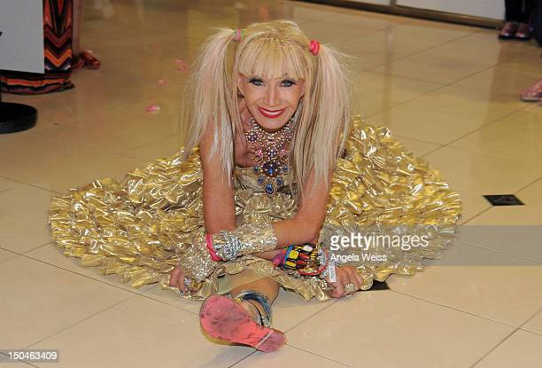 Fashion designer Betsey Johnson celebrates the 10 year anniversary of The Grove with a oneofakind anniversary shoe at The Grove on August 18 2012 in...