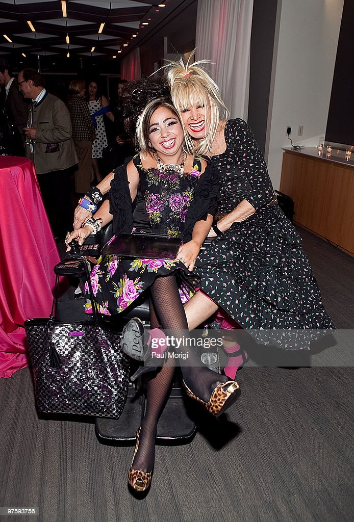 Fashion designer Betsey Johnson (R) poses for a photo with Juliette Rizzo  at An