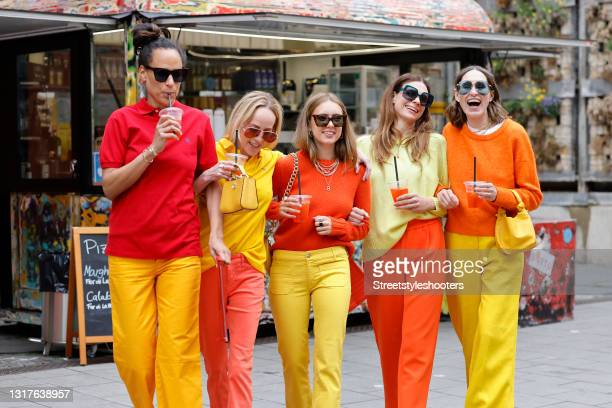 Fashion designer Bianca Vaitl wearing a red polo shirt by Ralph Lauren, yellow pants by The Seafarer, orange sandals by Prada, a red clutch by...