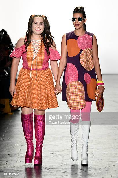 Fashion designer Bianca Zidik and a model walk the runway at The Art Institutes fashion show during New York Fashion Week The Shows September 2016 at...