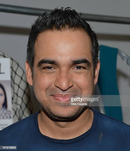 Fashion designer Bibhu Mohapatra poses backstage at his Fall 2013 fashion show during MercedesBenz Fashion Week at The Studio at Lincoln Center on...