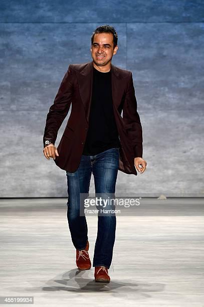 Fashion designer Bibhu Mohapatra walks the runway at the Bibhu Mohapatra fashion show during MercedesBenz Fashion Week Spring 2015 at The Pavilion at...