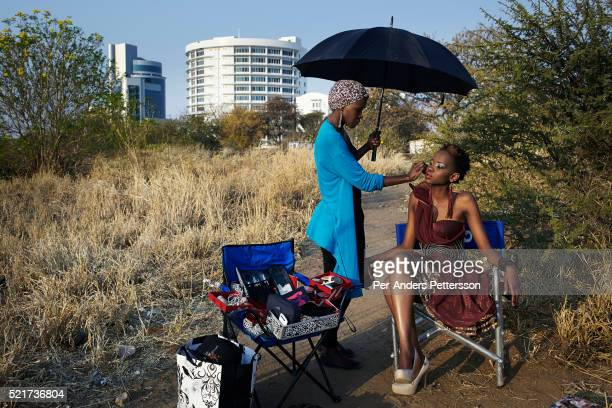 Fashion designer Blacktrash on a location shoot with a model on August 28 2012 in Gaborone Botswana He is one of Botswana's leading designers Color...