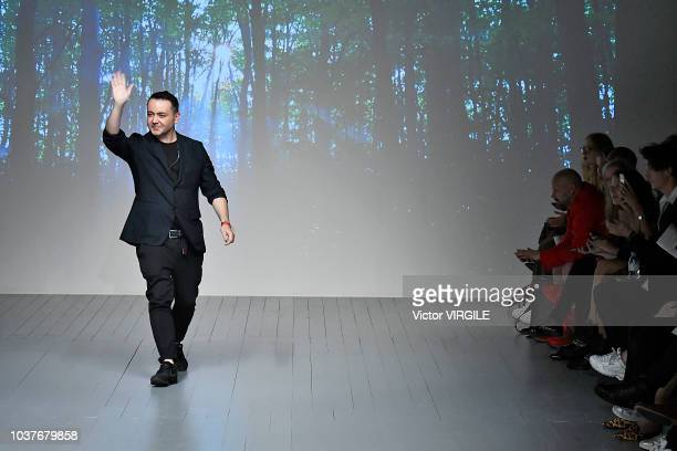 Fashion designer Bora Aksu walks runway at the Bora Aksu Ready to Wear Spring/Summer 2019 fashion how during London Fashion Week September 2018 on...