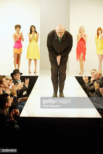 fashion designer bowing on runway - catwalk stock pictures, royalty-free photos & images