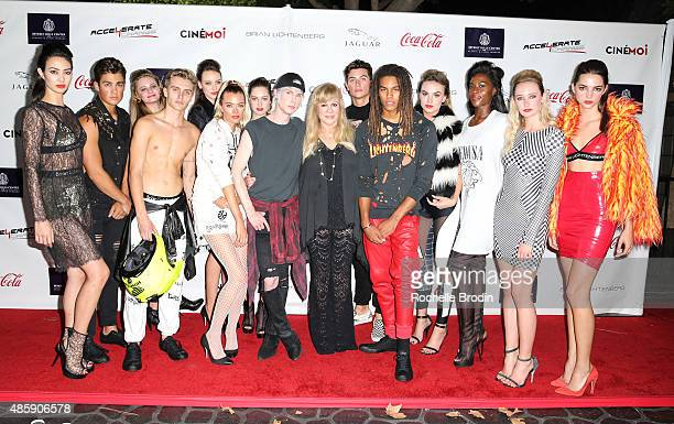 Fashion designer Brian Lichtenberg Daphna Ziman of Warner Estate and the models in the fashion show attend the Accelerate4Change charity event...