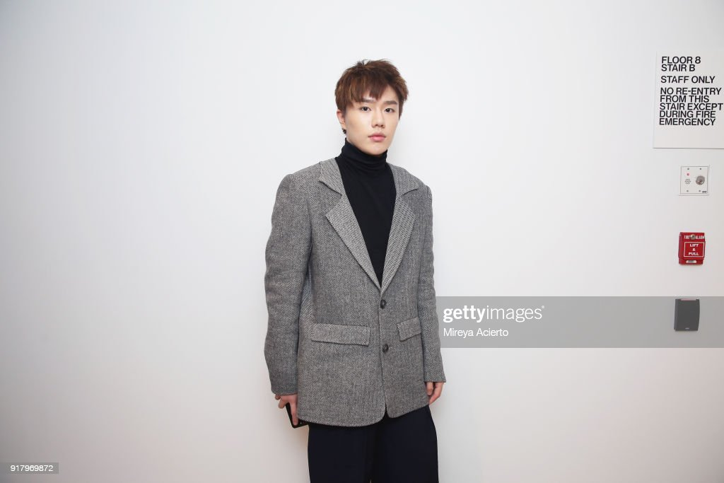 Fashion designer Calvin Luo poses backstage at the Calvin Luo fashion show during New York Fashion Week on February 13, 2018 in New York City.