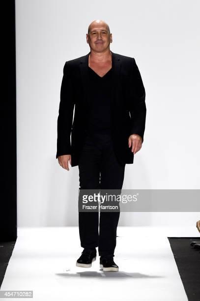 Fashion designer Carmen Marc Valvo walks the runway at the Carmen Marc Valvo 25th Anniversary fashion show during MercedesBenz Fashion Week Spring...