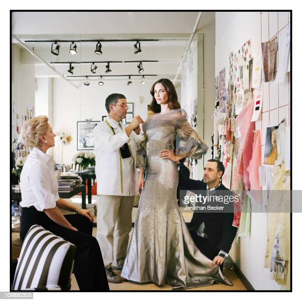 Fashion designer Carolina Herrera, her design team and model Eugenia Silva are photographed at her atelier for Vogue Espana on May 5, 2010 in New...