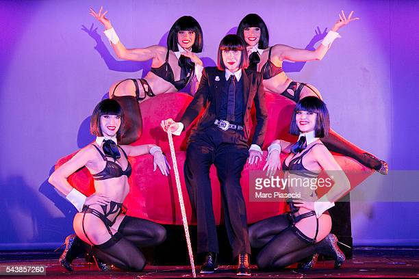 Fashion designer Chantal Thomass poses with the 'Crazy Girls' as the new collaborator for the next show 'Dessous Dessus' at Le Crazy Horse on June 30...