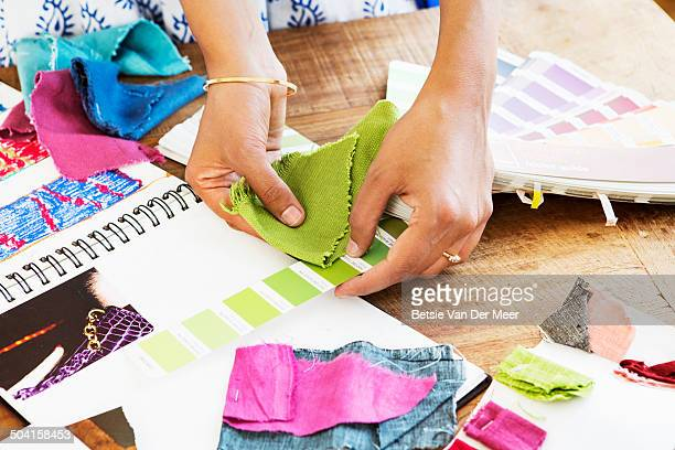 fashion designer choosing colors for fabric.