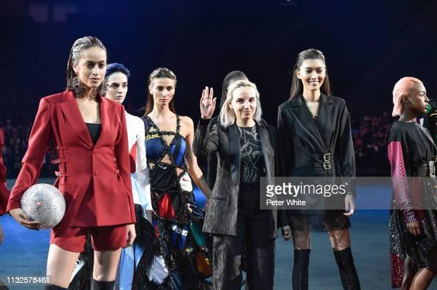Fashion designer Christelle Kocher walks the runway during the finale of Koche show as part of the Paris Fashion Week Womenswear Fall/Winter...