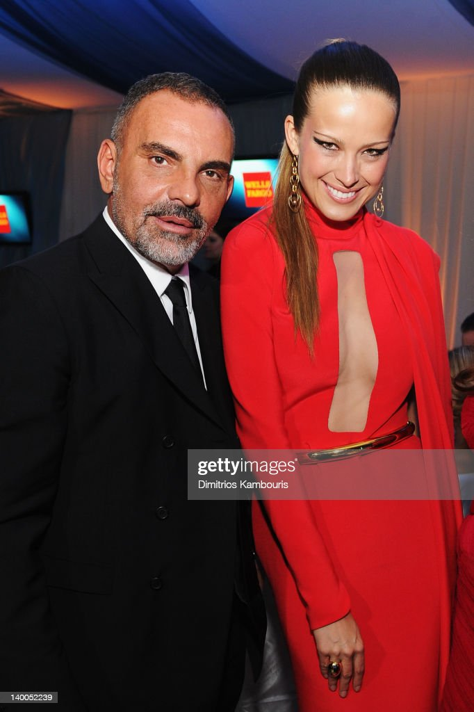 Fashion Designer Christian Audigier and Model Petra Nemcova attend the 20th Annual Elton John AIDS Foundation Academy Awards Viewing Party at The City of West Hollywood Park on February 26, 2012 in Beverly Hills, California.