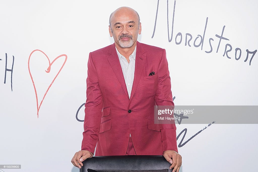 Fashion designer Christian Louboutin poses for a photo during a personal appearance at Nordstrom Downton Seattle on October 17, 2016 in Seattle, Washington.