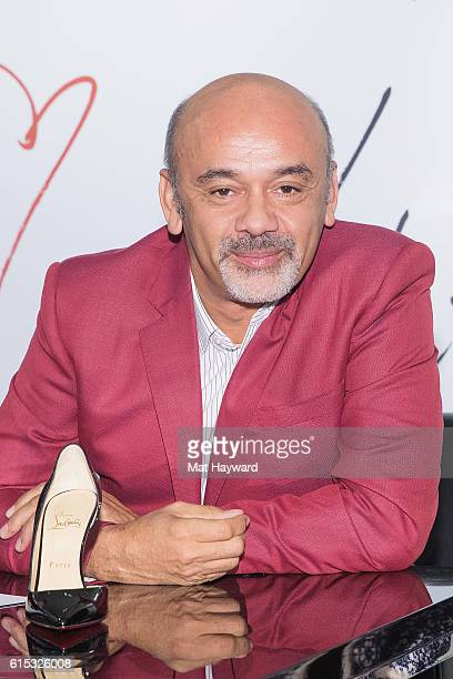 Fashion designer Christian Louboutin poses for a photo during a personal appearance at Nordstrom Downton Seattle on October 17 2016 in Seattle...