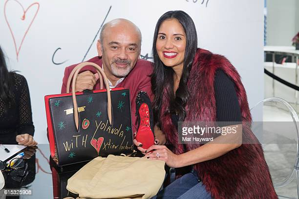 Fashion designer Christian Louboutin visits with a customer during a personal appearance at Nordstrom Downton Seattle on October 17 2016 in Seattle...