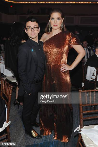 Fashion designer Christian Siriano and actress Debra Messing wearing Christian Siriano pose as Ketel One Vodka sponsors the 28th Annual GLAAD Media...