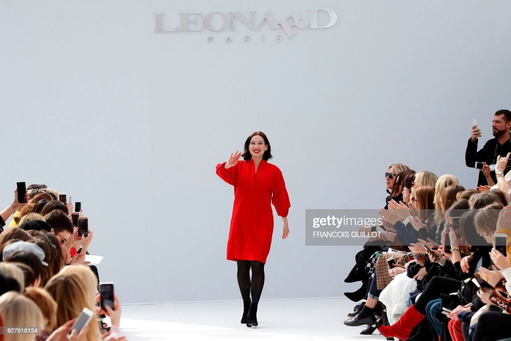 Fashion designer Christine Phung for Leonard Paris acknowledges the audience at the end of the 2018/2019 fall/winter collection fashion show on March 5, 2018 in Paris. /