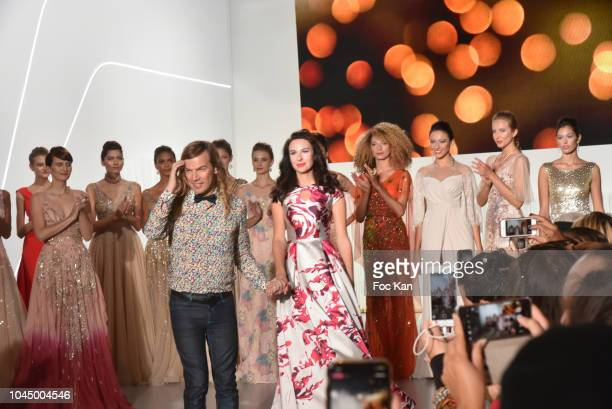 Fashion designer Christophe Guillarme and Mariana Voinova the bride walk the runway during the finale of the Christophe Guillarme show as part of the...