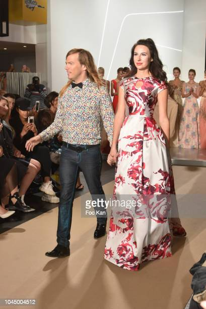 Fashion designer Christophe Guillarme and Mariana Voinova walk the runway during the Christophe Guillarme show as part of the Paris Fashion Week...