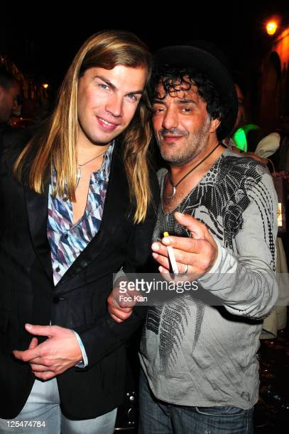 Fashion designer Christophe Guillarme and singer Rachid Taha attend the Banana Cafe 20th Anniversary Party at Banana Cafe on September 20 2010 in...