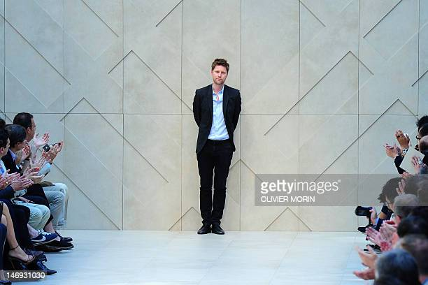Fashion designer Christopher Bailey acknowledges the audience at the end of Burberry Prorsum Spring-Summer 2013 Menswear collection on June 23, 2012...