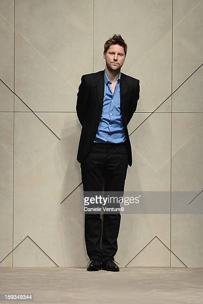 Fashion designer Christopher Bailey acknowledges the audience at the end of Burberry Prorsum show as part of Milan Fashion Week Menswear...