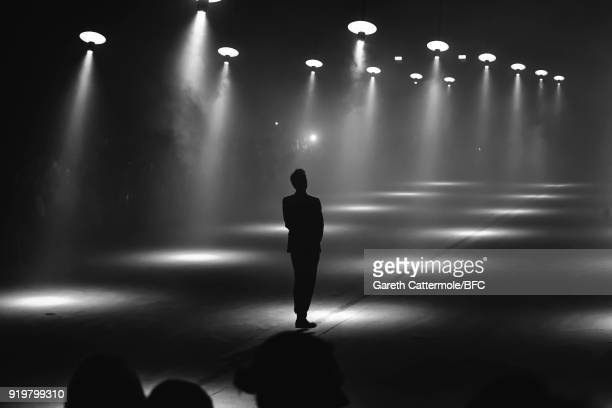 Fashion designer Christopher Bailey walks the runway at the Burberry show during London Fashion Week February 2018 at Dimco Buildings on February 17,...