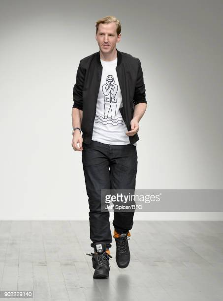 Fashion designer Christopher Raeburn on the runway after his show during London Fashion Week Men's January 2018 at BFC Show Space on January 7 2018...