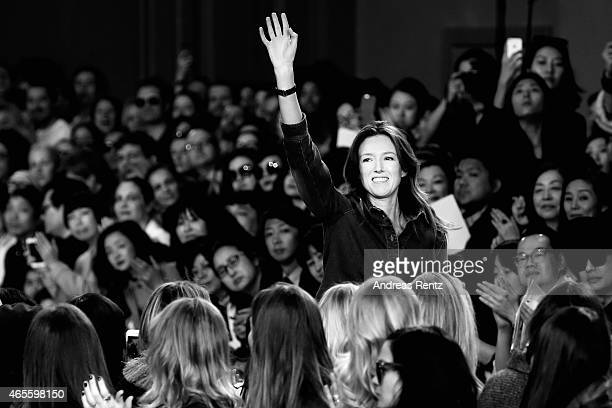 Fashion designer Clare Waight Keller acknowledges the applause of audience following the Chloe show as part of Paris Fashion Week Womenswear...