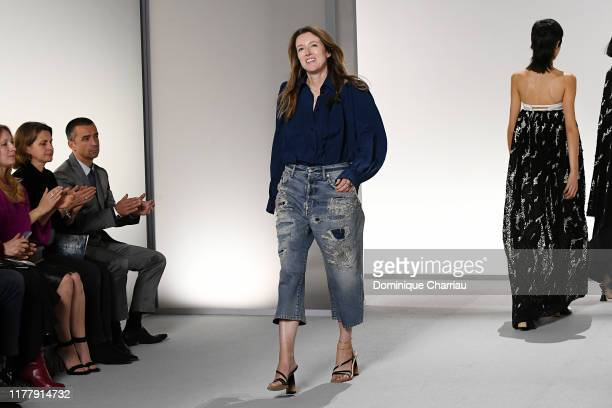 Fashion designer Clare Waight Keller acknowledges the applause of the audience after the Givenchy Womenswear Spring/Summer 2020 show as part of Paris...