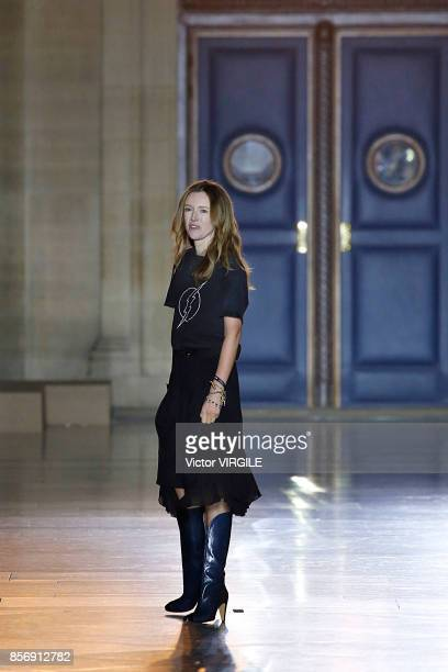 Fashion designer Clare Waight Keller walks the runway during the Givenchy Ready to Wear Spring/Summer 2018 fashion show as part of the Paris Fashion...