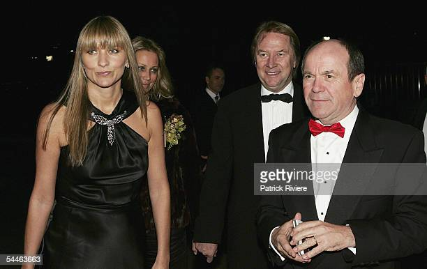 Fashion designer Collette Dinnigan and singer Glenn Shorrock arrive with Music manager Glenn Wheatley at The Mother Of All Balls at the Hordern...