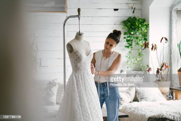 fashion designer creating gowns - design professional stock pictures, royalty-free photos & images