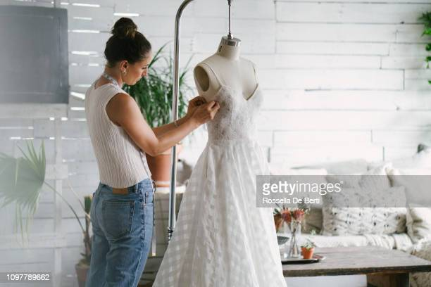fashion designer creating gowns - wedding dress stock pictures, royalty-free photos & images