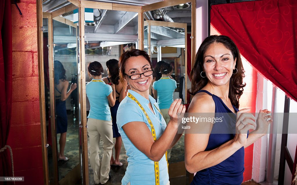 Fashion designer custom altering a dress : Stock Photo