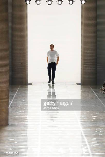 Fashion designer Daniel Lee acknowledges the applause of the audience at the Bottega Veneta show during the Milan Fashion Week Spring/Summer 2020 on...