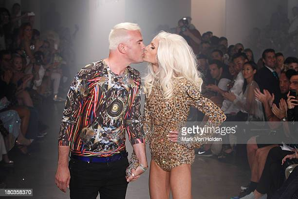 Fashion designer David Blond and Phillipe Blond walk the runway at The Blonds fashion show during MADE Fashion Week Spring 2014 at Milk Studios on...