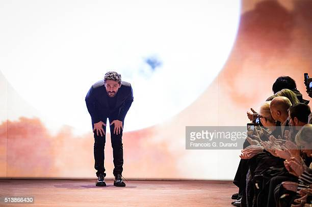 Fashion designer David Koma acknowledges the audience at the end of the Mugler show as part of the Paris Fashion Week Womenswear Fall/Winter...