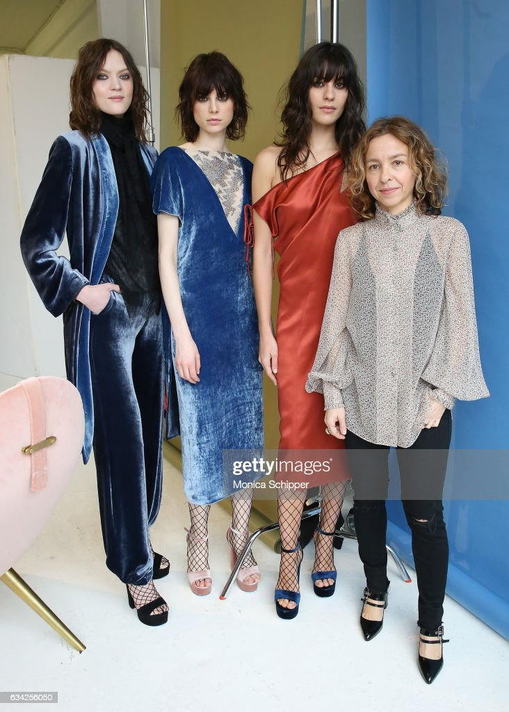 Fashion designer Denitza Skorcheva (R) poses for a photo with models at the Roumel 6 Presentation during February 2017 New York Fashion Week at Drift Studios on February 8, 2017 in New York City.