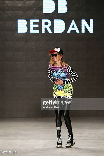 Fashion designer Deniz Berdan acknowledges the applause of the audience after the DB Berdan show during Mercedes Benz Fashion Week Istanbul SS15 at...