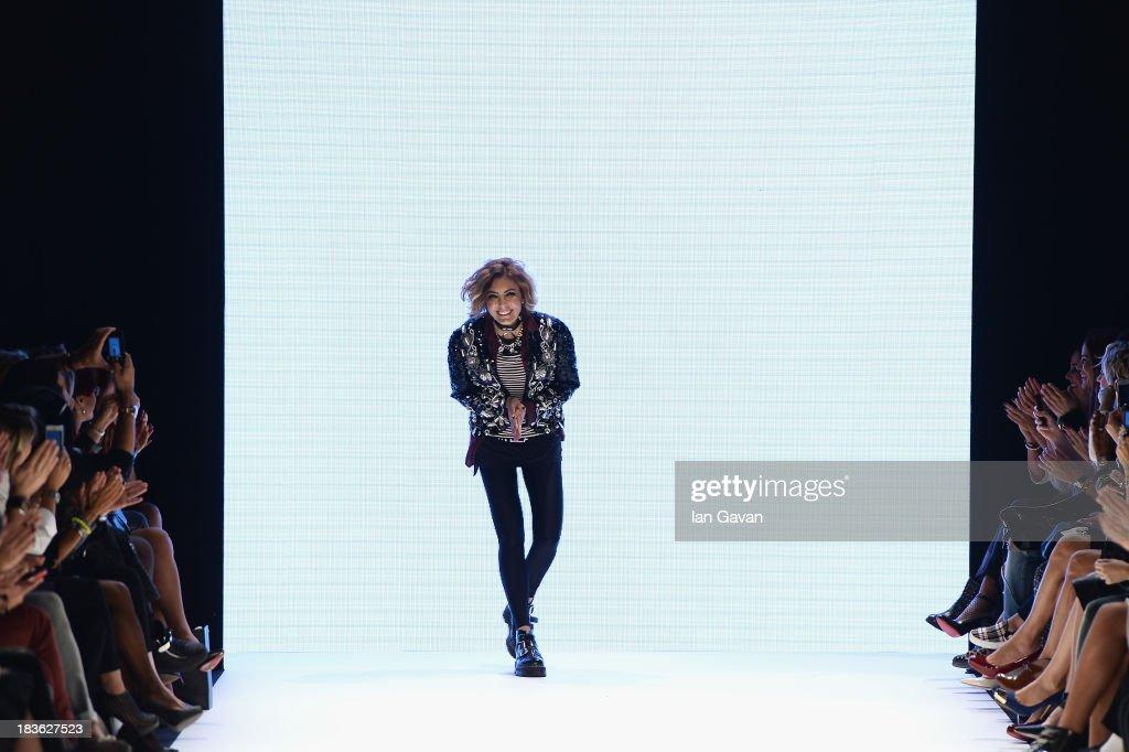 Fashion designer Deniz Berdan walks the runway at the DB Berdan show during Mercedes-Benz Fashion Week Istanbul s/s 2014 presented by American Express on October 8, 2013 in Istanbul, Turkey.