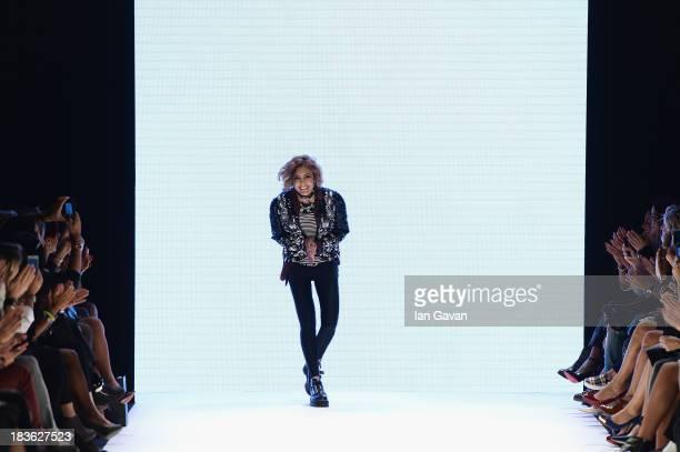Fashion designer Deniz Berdan walks the runway at the DB Berdan show during MercedesBenz Fashion Week Istanbul s/s 2014 presented by American Express...
