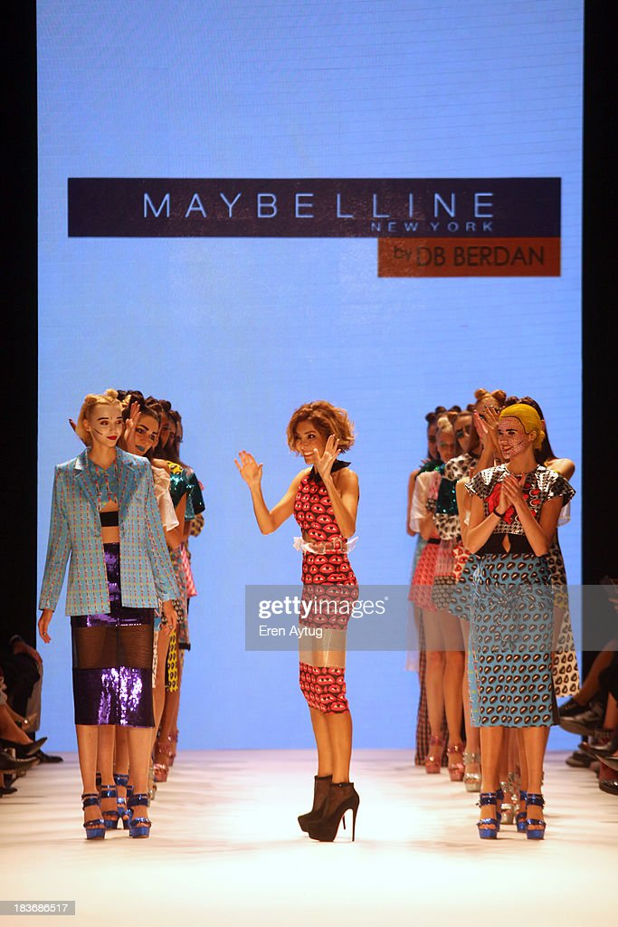 Fashion designer Deniz Berdan walks the runway at the Maybelline New York By DB Berdan show during Mercedes-Benz Fashion Week Istanbul s/s 2014 presented by American Express on October 8, 2013 in Istanbul, Turkey.