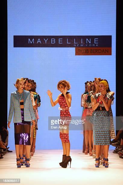 Fashion designer Deniz Berdan walks the runway at the Maybelline New York By DB Berdan show during MercedesBenz Fashion Week Istanbul s/s 2014...
