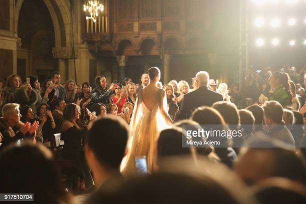 Fashion designer Dennis Basso walks down the runway during the Dennis Basso fashion show at St Bartholomew's Church on February 12 2018 in New York...