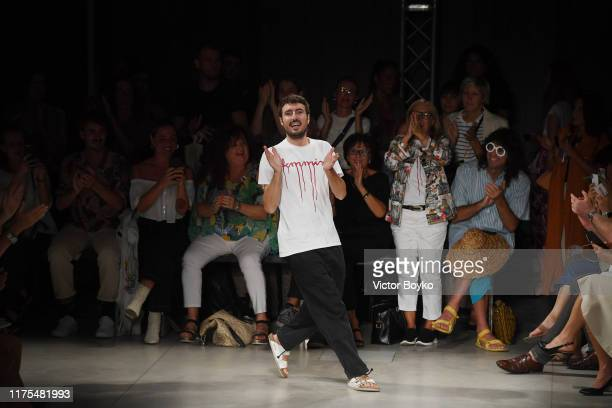 Fashion designer designse Marco Rambaldi acknowledges the applause of the audience at the Marco Rambaldi show during the Milan Fashion Week...