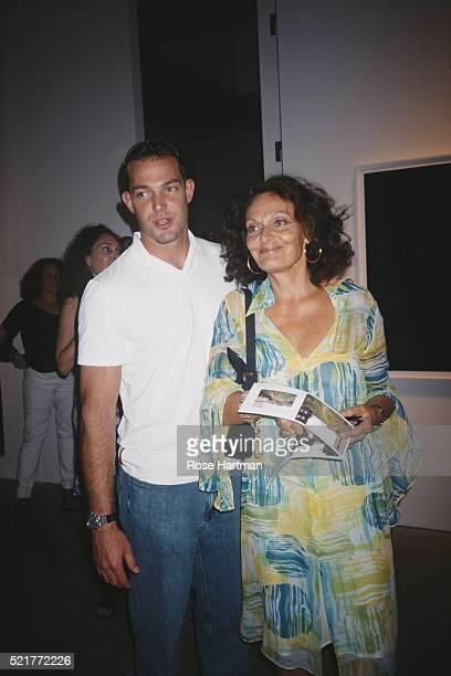 Fashion designer Diane von Furstenberg poses with her son Alex in Greenwich Village studio New York New York 2000