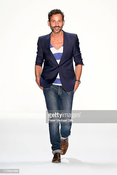 Fashion designer Dimitrios Panagiotopoulos on the runway after his Dimitri show during MercedesBenz Fashion Week Spring/Summer 2014 at Brandenburg...